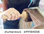 closeup and cropped image of... | Shutterstock . vector #699584008