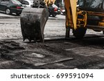 repair of roads  the excavator... | Shutterstock . vector #699591094