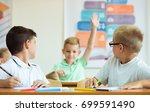 portrait of schoolboy raises... | Shutterstock . vector #699591490
