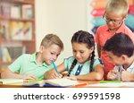happy group of school children... | Shutterstock . vector #699591598
