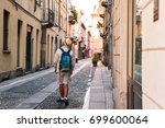 young tourist man exploring the ... | Shutterstock . vector #699600064
