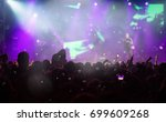 crowd at concert   cheering... | Shutterstock . vector #699609268