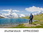 hiker with backpack on the... | Shutterstock . vector #699610360