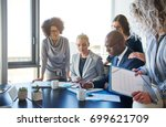 group of focused businesspeople ... | Shutterstock . vector #699621709