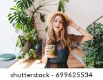 attractive long haired girl in... | Shutterstock . vector #699625534