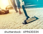 young woman using a vacuum... | Shutterstock . vector #699630334