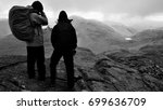 Lone Hikers Descend From...