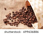 brown coffee beans spilled from ... | Shutterstock . vector #699636886