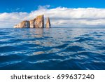 rocks stick out of the water .. ... | Shutterstock . vector #699637240