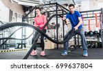 woman and man in gym functional ... | Shutterstock . vector #699637804