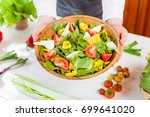 hands holding an healthy fresh... | Shutterstock . vector #699641020