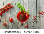 glass of bloody mary on a... | Shutterstock . vector #699647188