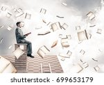 young businessman sitting on... | Shutterstock . vector #699653179