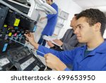 technician using a tablet to... | Shutterstock . vector #699653950