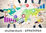 group of people with devices in ... | Shutterstock . vector #699654964