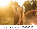 a young woman enjoys life.... | Shutterstock . vector #699656098