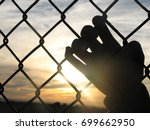 Hand On Chain Link Fence...