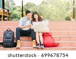 happy asian couple traveler... | Shutterstock . vector #699678754