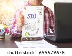 business man holding seo and... | Shutterstock . vector #699679678
