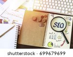 top view of seo and graph paper ... | Shutterstock . vector #699679699