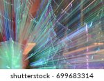 Small photo of Abstract of zoom in or zoom out long exposure a colorful ribbon hanging a party.