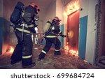 firemans team during... | Shutterstock . vector #699684724