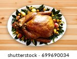 stuffed cooked turkey with... | Shutterstock . vector #699690034