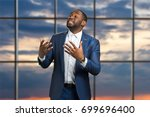 black businessman passionately... | Shutterstock . vector #699696400