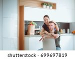 beautiful young couple is... | Shutterstock . vector #699697819