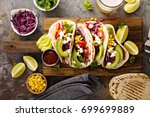 pulled pork tacos with red... | Shutterstock . vector #699699889