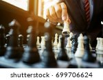 businessman playing chess on... | Shutterstock . vector #699706624