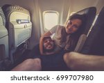 young handsome couple taking a... | Shutterstock . vector #699707980
