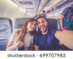 young handsome couple taking a... | Shutterstock . vector #699707983