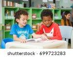 row of multiethnic elementary...   Shutterstock . vector #699723283