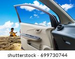 in the car  the child playing... | Shutterstock . vector #699730744