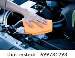 wipe cleaning the car engine... | Shutterstock . vector #699731293