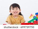 asian cute girl playing | Shutterstock . vector #699739750