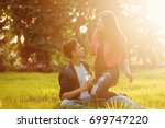 a loving couple of teenagers.... | Shutterstock . vector #699747220