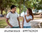 lovers in the park | Shutterstock . vector #699762424