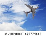 airplane in the sky  ... | Shutterstock . vector #699774664