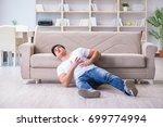 man suffering from sick stomach ... | Shutterstock . vector #699774994