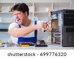 computer repairman repairing... | Shutterstock . vector #699776320
