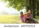 a young family reading the... | Shutterstock . vector #699792514