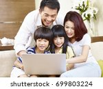 happy asian family with two... | Shutterstock . vector #699803224
