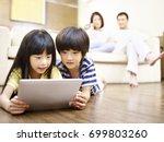two asian children lying on... | Shutterstock . vector #699803260