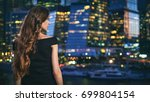 pretty woman is looking at... | Shutterstock . vector #699804154