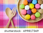 colorful delicious macarons in... | Shutterstock . vector #699817369