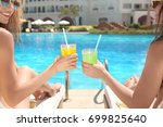 young girls with drinks... | Shutterstock . vector #699825640