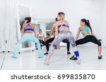 rear view of fit young girls... | Shutterstock . vector #699835870