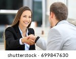 two executives meeting and... | Shutterstock . vector #699847630